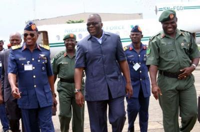 Gen AZAZI(in safari suit) with Air Chief Marshal PETINRIN(photo~Daily Times of Nigeria)