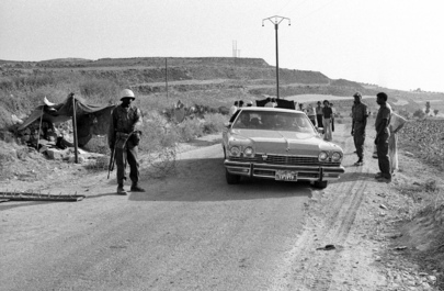 Nigerian UNIFIL troops conduct security checks on cars in Lebanon, 1978