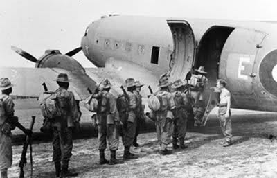 Troops of the Nigeria Regiment, 3rd West African Brigade (Thunder), boarding a Dakota Transport