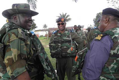 Gen S-Y Bello(l)(then JTF Commander) with outgone CDS, ACM (rtd)PAUL DIKE(c)in the Niger Delta,2010