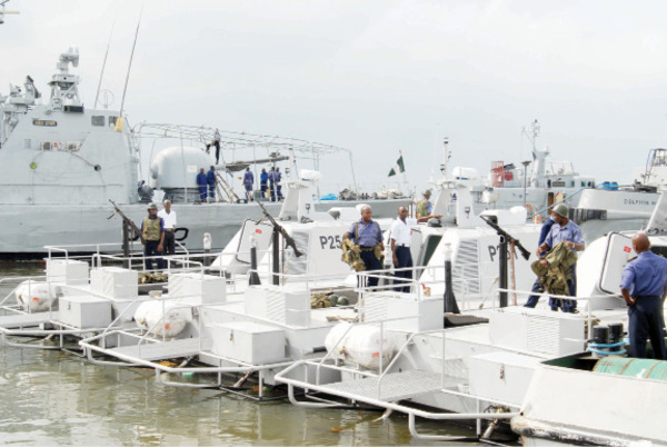 Nigerian Navy anti-piracy MANTA ASD Littoral Interceptors.In the background,a 58-metre missile craft