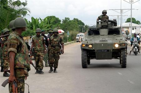 JTF troops advance with a Panhard VBL M11 recce vehicle