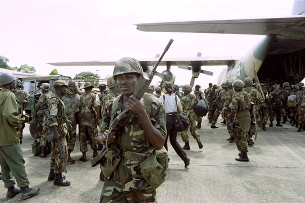 Nigerian ECOMOG troop reinforcements disembark from a NAF C130 at Lungi, Sierra Leone, 28 May 1997