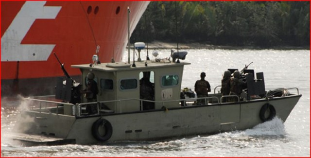 JTF troops escort shipping in a Suncraft(Singapore) gunboat with three 12.7mm weapon stations..fore, aft and starboard
