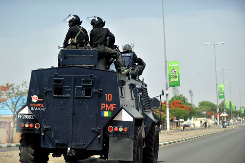 An Alvis Saxon mine-resistant APC of the Police Mobile Force(MOPOL)