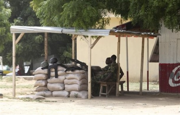 Joint Security Task Force counterinsurgency troops man a machine-gun nest in Maiduguri