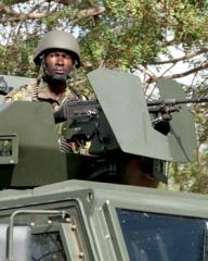 Kenya Army soldier mans a weapon atop a Puma M26 MRAP