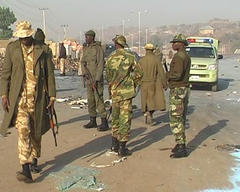 Troops of the Special Task Force cordon off the scene of a bomb blast on the Jos Plateau