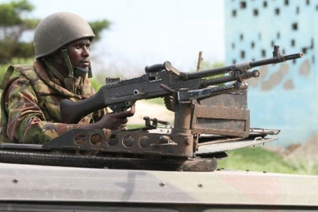 Kenya Army soldier mans a machine gun