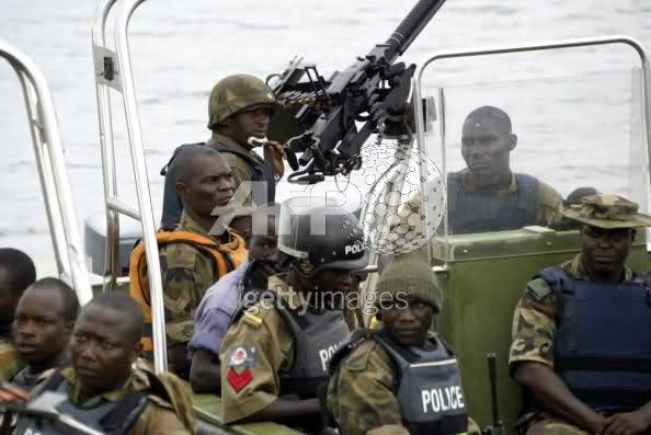 JTF combined forces patrol in Scorpion Mk.II river gunboats.The chap with red stripes is a MOPOL man