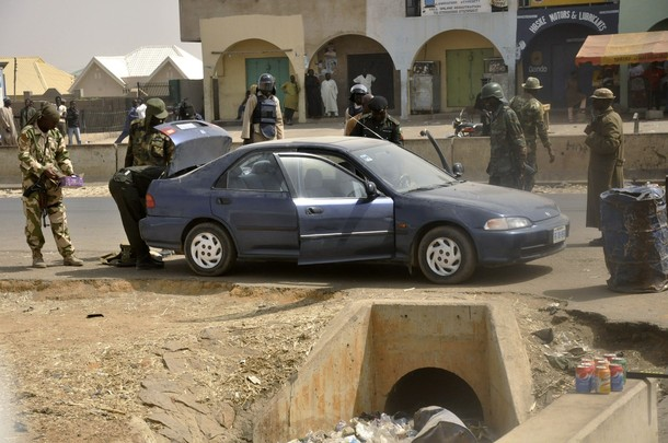 Troops of the 3 Brigade, Nigerian Army search a suspicious-looking vehicle at Kano, 22 Jan.2012