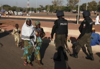 Men of the Police Mobile Force(MOPOL) on foot patrol in a terror-afflicted zone