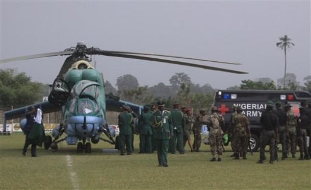 Nigerian Army troops and a new Nigerian Air Force Mi-24 Hind attack helicopter
