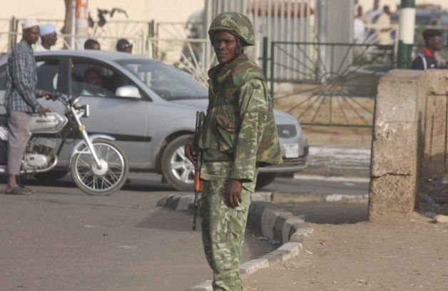 Soldier of the 1 Mechanised Division's 3 Motorised Brigade does his duty in Kano
