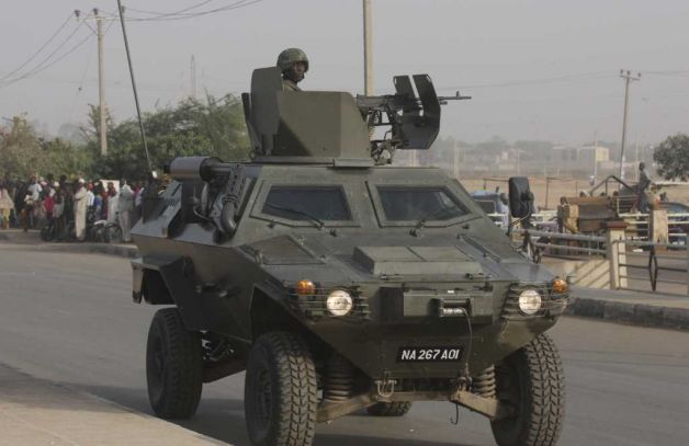 A Nigerian Army Otokar Cobra APC on urban counterterrorism+counterinsurgency operations in Kamo