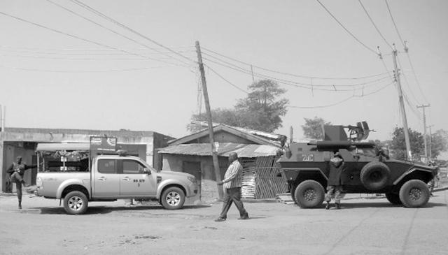 Soldiers in an Otokar Cobra APC and MOPOL cops in Ford Ranger 4WD truck on joint urban operations