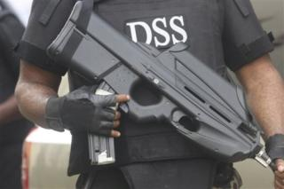 An operative of the SSS, Nigeria's secret police
