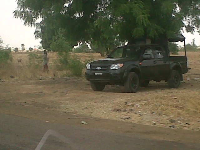4WD truck of the Nigerian Army parked at the ready at a checkpoint along the Kaduna-Zaria Expressway