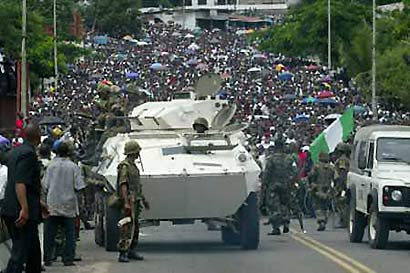 Nigerian ECOMIL troops arrive to a tumultous  welcome in Monrovia, signposting the return of peace