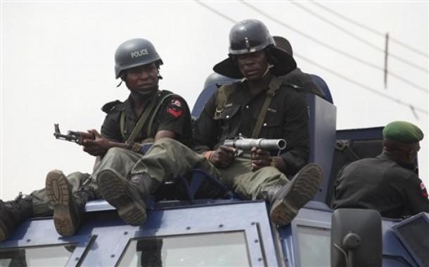 Men of the Police Mobile Force(MOPOL) atop an Otokar Cobra APC advance in northern Nigeria