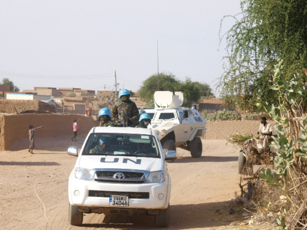 Nigerian UNAMID peacekeepers patrol in a Toyota Hilux and an Otokar Cobra in Darfur, Sudan