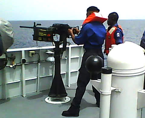 Nigerian Navy seamen man a weapon station onboard a Sea Eagle Offshore Patrol Craft