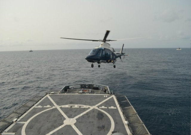 An Agusta A109e Power of the Nigerian Navy Air Arm prepares to land on NNS Thunder F90
