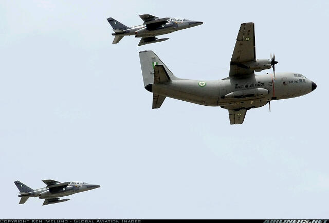 An upgraded Alenia G222 medium lift plane flanked by a pair of upgraded Alpha Jet aircraft