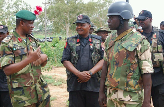 Maj Gen Ken Osuji,Commd't NA School of Infantry(l) and Brig Gen Tijani Golau, Director CTCIC(c)