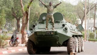 Renegade Malian soldier atop a BTR 60 APC near the Presidential Palace following a coup d'etat