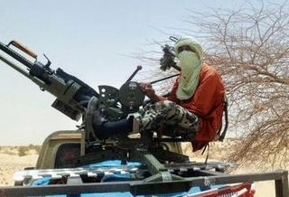 Mali rebel mans a truck-mounted anti-aircraft weapon