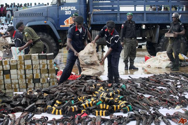 An affiliated faction of Niger Delta militants hand in their weapons 22-8-2009