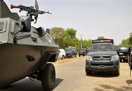 An Army-owned Otokar Cobra APC and a Police Toyota Hilux 4WD truck on joint urban CT-COIN operations