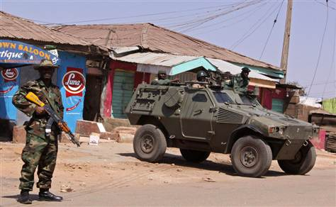 Nigerian troops and Panhard VBL M11 scout car on urban operations