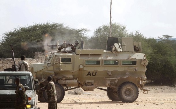 A Ugandan soldier engages an Al Shabaab ambush party from a Casspir MRAP while Somali troops watch