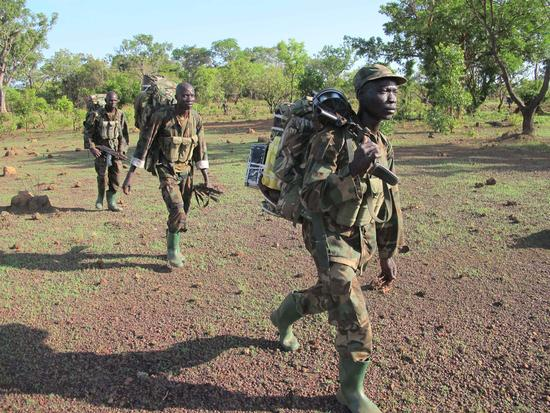 Ugandan UPDF troops trekking in the forests of the Central African Republic in pursuit of the LRA