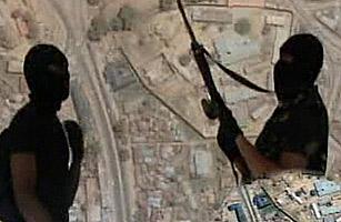 Boko Haram militants pose in front of satellite imagery of Bauchi, NE Nigeria
