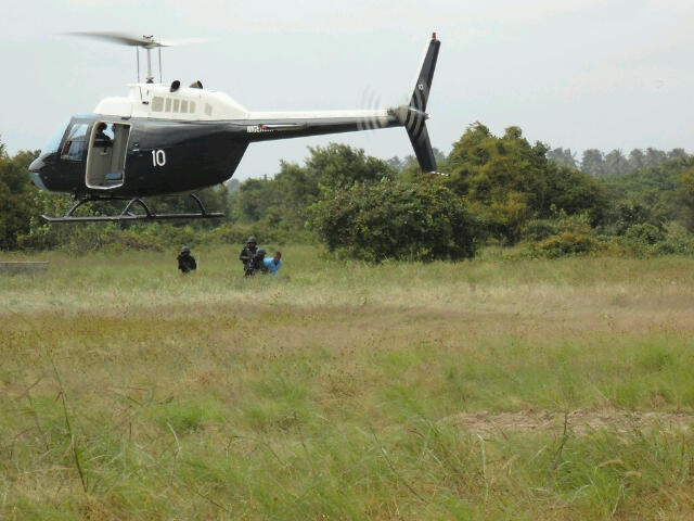 A Bell helicopter of the Navy Air Arm(first-ever photo) arrives to extract SBS commandos and captive