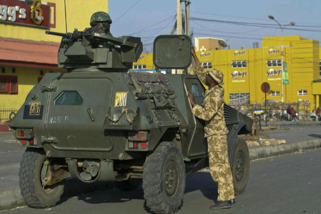 Troops and Panhard VBL M11 scout car of the STF on urban CTCOIN operations on the Jos Plateau