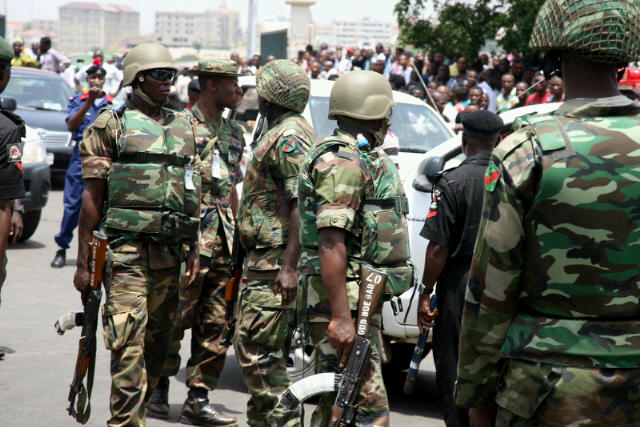 Nigerian Army soldiers react to a bomb scare