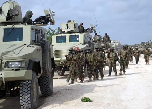 Ugandan AMISOM troops and Mamba MRAP vehicles