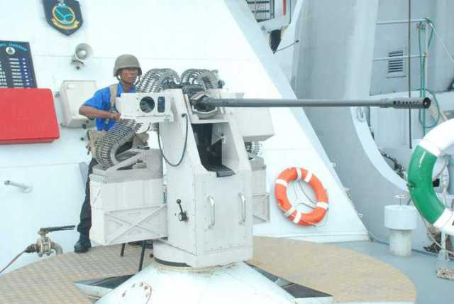 A Nigerian Navy seaman mans a 20mm weapon