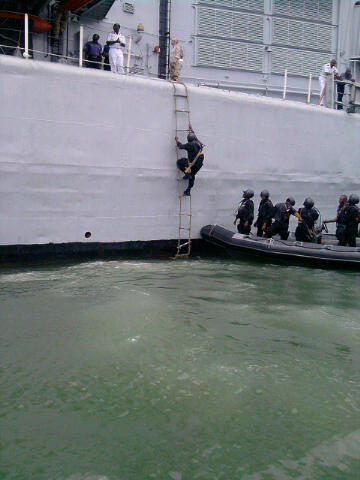 Navy SBS commandos prepare to board the NNS Thunder F90 during a drill