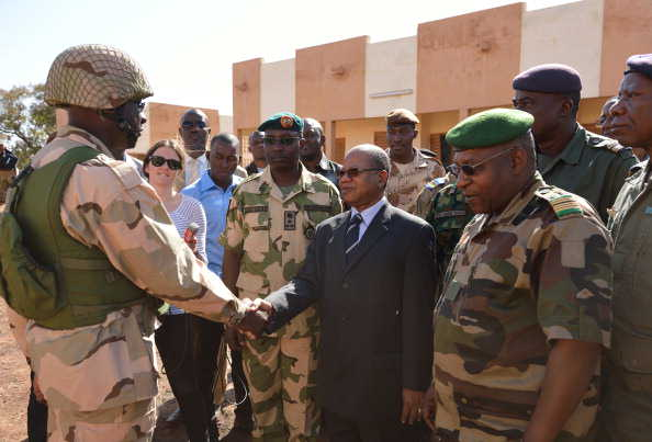 The detachment commander of Nigerian troops is greeted by an official on arrival at Bamako