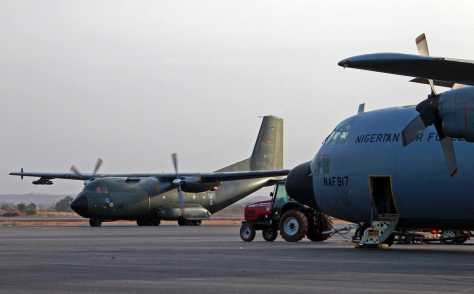 A Nigerian Air Force C130 Hercules(fore) and a French military transport plane at Bamako Airport