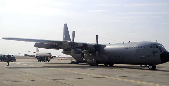A Nigerian Air Force C130-H30 on the tarmac at Kaduna prepares to depart for Mali