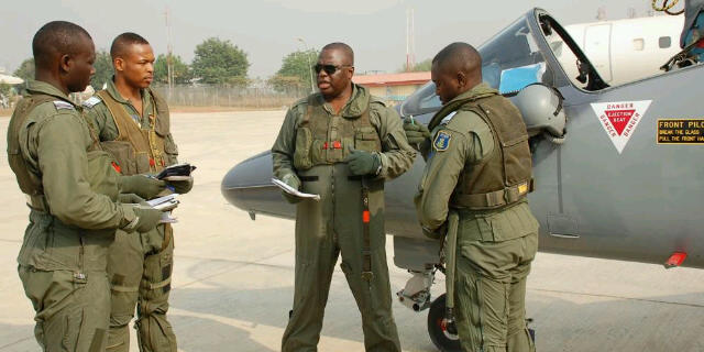 Nigerian Air Force Alpha Jet pilots receive a pre-flight briefing from Air Component Commander, Air Vice Marshal Tayo Oguntonyibo(2nd right)prepare to take off to Niger from Abuja