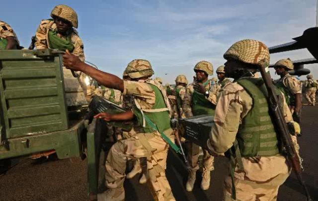 Nigerian troops board vehicles at Bamako Airport