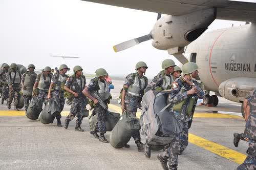 Tavor rifle-wielding ground troops of the Nigerian Air Force board a G222 plane enroute Niamey