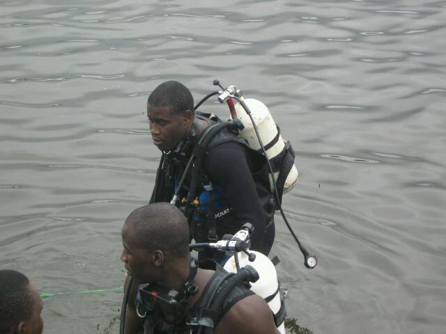 Nigerian Navy Special Boat Service personnel prepare to go underwater